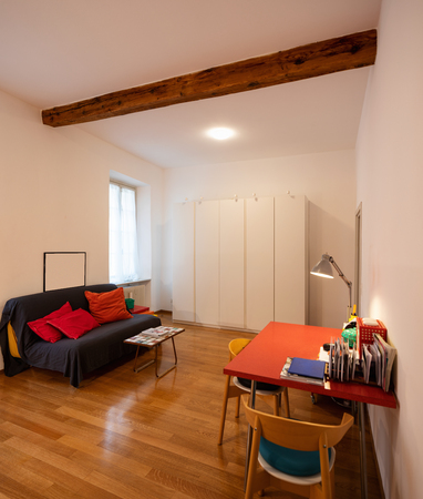Relaxation room with sofa in a newly renovated apartment. Nobody inside