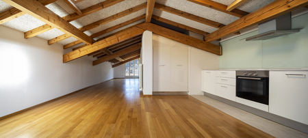 Kitchen in empty apartment with wooden beams. Nobody inside Stock Photo
