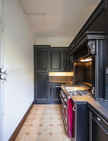 Kitchen with black wooden doors and white walls. Nobody inside Standard-Bild - 114299887