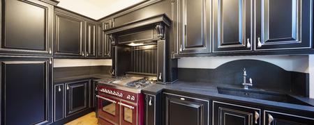 Kitchen with black wooden doors and white walls. Nobody inside Standard-Bild - 114299889