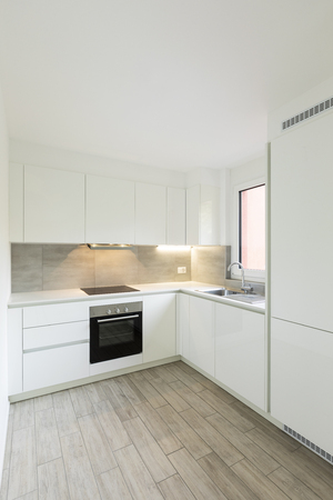 White kitchen with black oven and sink. Nobody inside Standard-Bild - 114299926