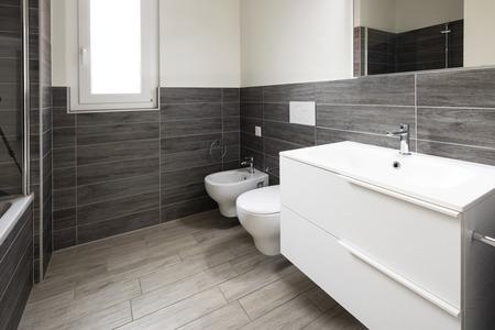 Bathroom with elegant minimalist brown tiles. Nobody inside Standard-Bild - 114299936