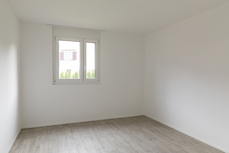 Empty room with white walls and window with a view. Nobody inside Standard-Bild - 114299938