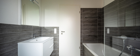 Bathroom with elegant minimalist brown tiles. Nobody inside Standard-Bild - 114299939