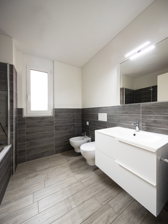 Bathroom with elegant minimalist brown tiles. Nobody inside Standard-Bild - 114299940