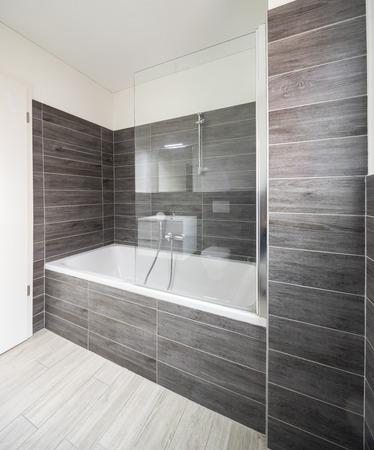 Bathroom with elegant minimalist brown tiles. Nobody inside Standard-Bild - 114299942