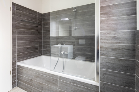 Bathroom with elegant minimalist brown tiles. Nobody inside Standard-Bild - 114299943