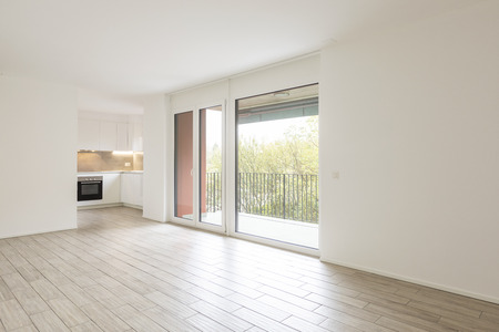Open space living room with large windows overlooking the nature. Nobody inside Standard-Bild - 114299979