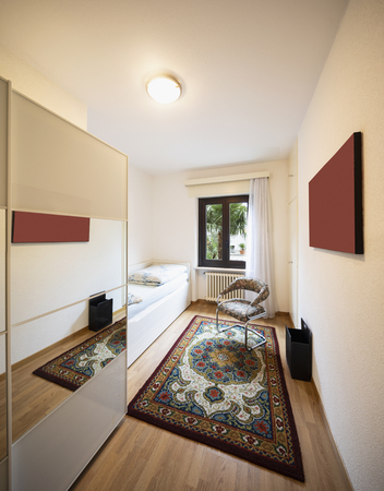 Bedroom with bed, chair and wardrobe. Nobody inside Standard-Bild - 114299985
