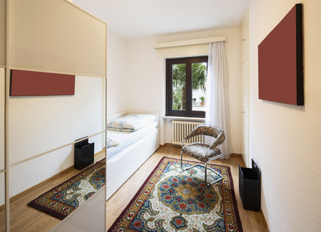 Bedroom with bed, chair and wardrobe. Nobody inside Standard-Bild - 114299991