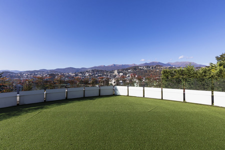 Terrace with synthetic lawn overlooking the city of Lugano in Switzerland. Nobody inside Standard-Bild - 114300014