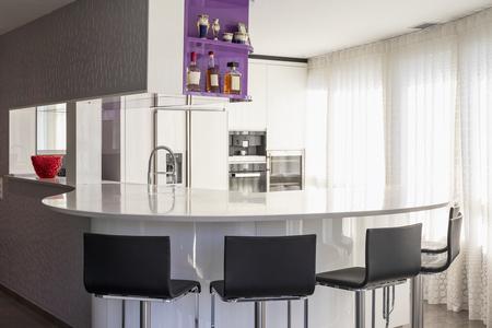 Kitchen with purple and white wardrobe, black counter. Elegant and minimalist. Nobody inside Standard-Bild - 114303377