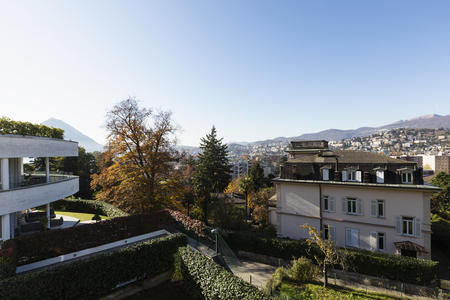 Terrace with synthetic lawn overlooking the city of Lugano in Switzerland. Nobody inside Standard-Bild - 114303388