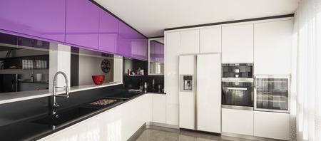 Kitchen with purple and white wardrobe, black counter. Elegant and minimalist. Nobody inside Standard-Bild - 114303390