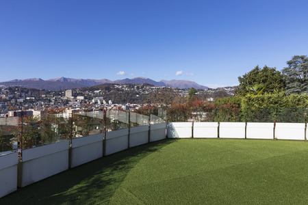 Terrace with synthetic lawn overlooking the city of Lugano in Switzerland. Nobody inside Standard-Bild - 114303391