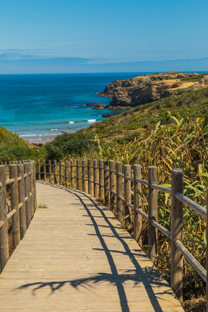 Wooden path on the beach of a natural park in Portugal with ocean view 写真素材