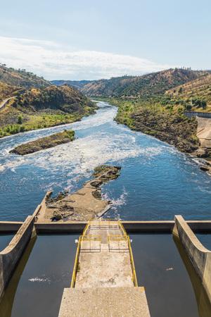 Landscape over the dam of Barragem do Fratel in Portugal during summer day