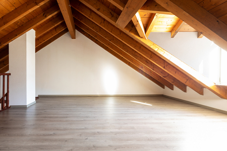Bright attic with wooden beams and parquet. Nobody inside