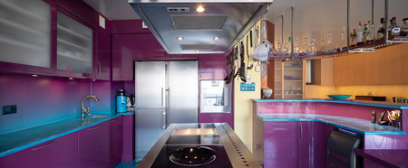 Modern elegant purple and blue kitchen in a luxury apartment. No one inside Archivio Fotografico - 121645958