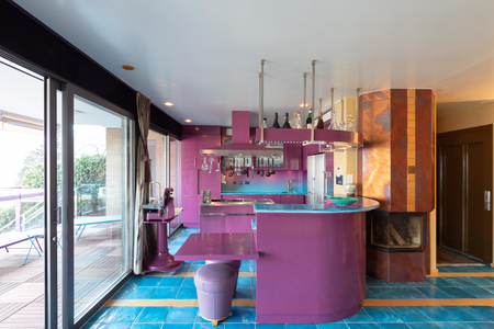 Modern elegant purple and blue kitchen in a luxury apartment. No one inside Archivio Fotografico - 121646005