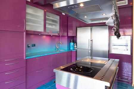 Modern elegant purple and blue kitchen in a luxury apartment. No one inside