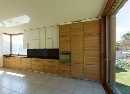 Interior of a wide modern and empty kitchen, it is a new house.