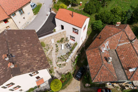 Small rustic country house exterior, nobody around and Swiss linear architecture, top view, photo taken with a drone