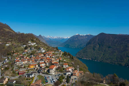 Aerial view of Lugano lake and the Monte Brè village in Canton Ticino in southern Switzerland. Sunny day