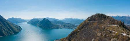 Aerial view of Lugano lake, Lugano city and Monte Brè in Canton Ticino in southern Switzerland. Sunny day
