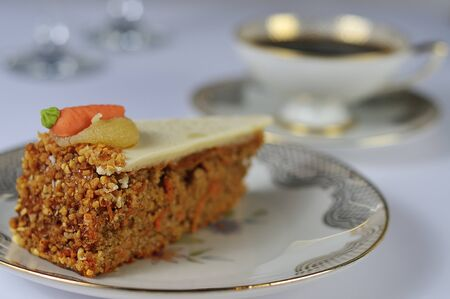 delicious carrot cake with antique coffee set photo
