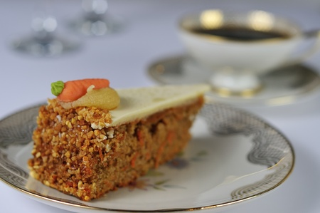 closeup from a carrot cake with antique coffee set photo