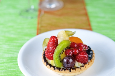 fruit tarte with green and red background photo