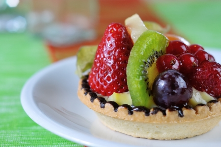 fruit tarte, closeup with green background photo