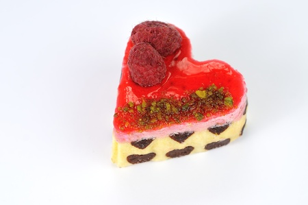 a heart shaped tarte with raspberries close up photo