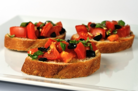 tasty bruschetta on white plate  photo