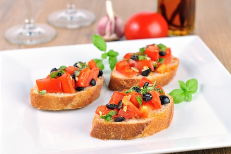 glases: hot bruschetta on wooden table and white plate with glases