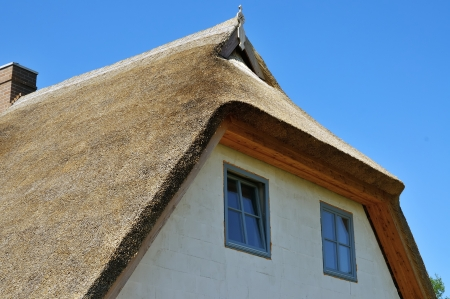thatched house: unfinished house with thatched roof