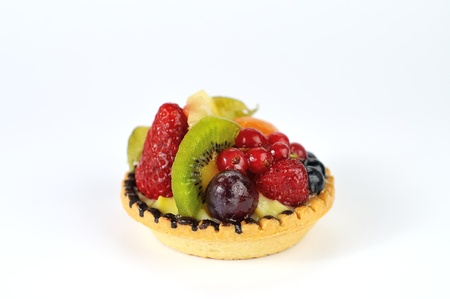 fruit tarte on white background closeup photo