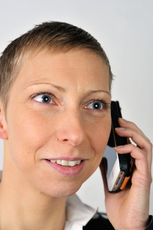 blonde businesswoman with a mobile is calling  photo