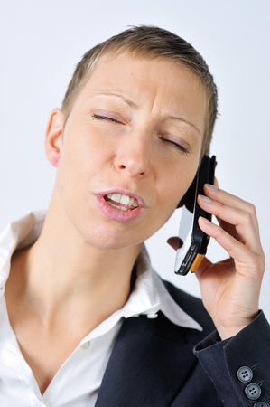 blonde businesswoman with a mobile is stressed Stock Photo - 20598736