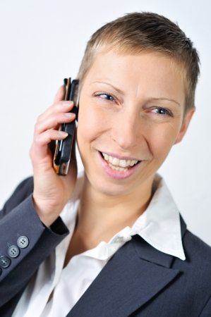 well-dressed blonde businesswoman with a mobile is calling  photo