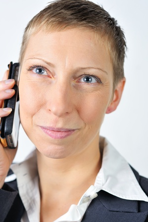 happy blonde businesswoman with a mobile is calling  photo