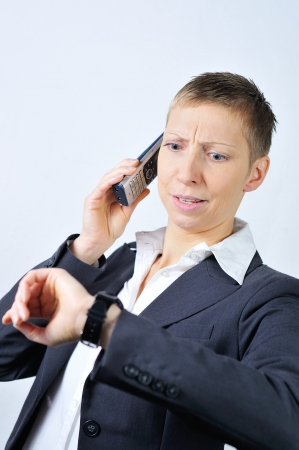 blonde businesswoman with a phone is stressed photo