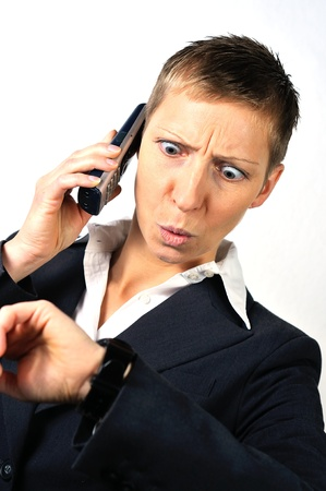 desperate blonde businesswoman with a phone is calling and white background photo