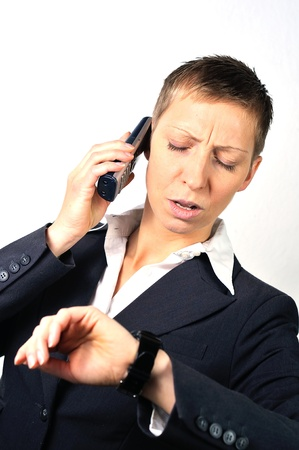 desperate and stressed blonde businesswoman with a mobile is calling  photo