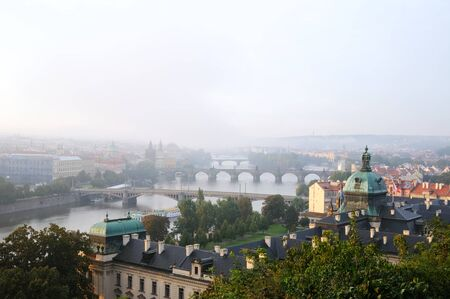 overwiew about prague early in the morning with fog photo