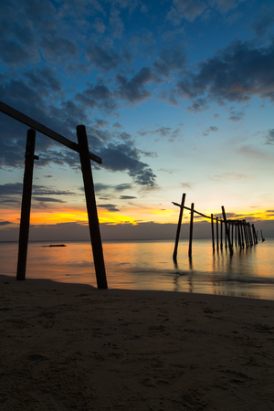 The wooden bridge is broken on the beach at sunset time, Phang-nga Thailand