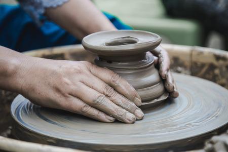 Closed up hands man using mechanic pottery made earthenware. Zdjęcie Seryjne