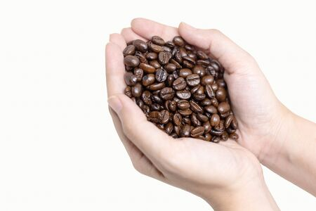 Coffee beans - Close up of person holding coffee beans in hands. Zdjęcie Seryjne