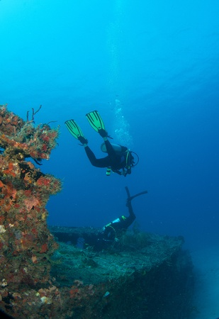 Divers on a shipwreck in south east Florida. photo